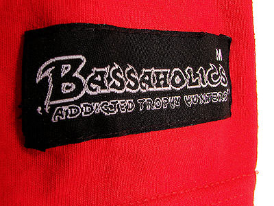 Sewn on bass tags at the bottom of all shirts.