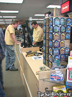 Talking over the latest fishing tackle
