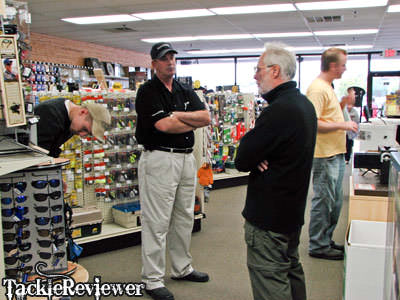 Shimano's finest going over tackle with buyers.